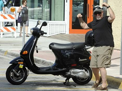 February 7, 2011: Billy Joel is seen having lunch and walking on Lincoln Road Mall before departing on his Vespa scooter in Miami Beach, Florida. Credit: INFphoto.com Ref: infusmi-11/13|sp|